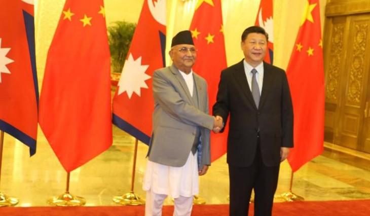 चीनको बेइजिङस्थित ग्रेट हल अफ पिपलमा बुधबार चिनियाँ राष्ट्रपति सी जिनपिङसँग शिष्टाचार भेटवार्ता गर्दै प्रधानमन्त्री केपी शर्मा ओली । तस्बिर- रासस
